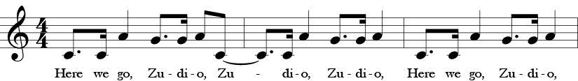 "First three measure of ""Here We Go, Zudio"" Treble clef 4/4 time signature. Dotted eighth C, 16th C, A quarter note, dotted eight G, 16th G, eighth A, eigth C, tied to dotted eigth C, 16th C, quarter note A, dotted eigth G, sixteeth note G, quarter note A, dotted eigth C, 16th C, quarter note A, dotted eigth G, sixteenth G, quarter note A. Words are Here we go, Zudio, Zudio, Zudio, Here we go Zudio."
