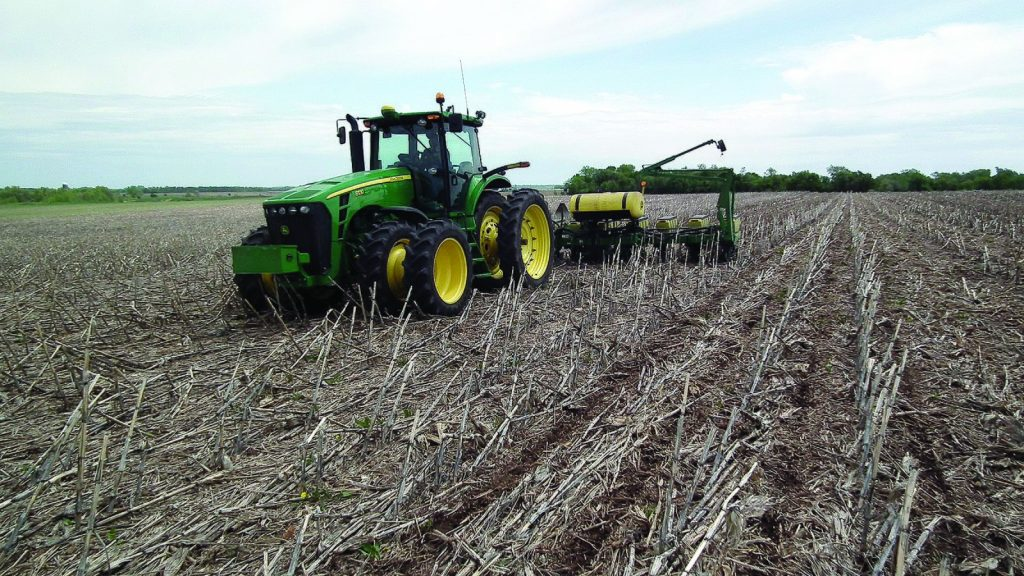a tractor preparing a field for planting